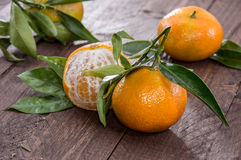 Fresh Tangerine with leaves. On wood Stock Photo
