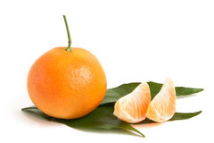Fresh tangerine with leaves and segments Stock Photo