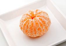Fresh tangerine on a plate. Royalty Free Stock Photos