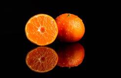 Fresh Tangerine with water splash cut. Tangerine with water splash fresh, wet, clear tropical, cut royalty free stock photos