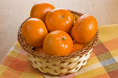 Fresh tangerine in wicker basket Royalty Free Stock Photo