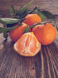 Fresh tangerine on wooden background royalty free stock photography