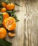 Fresh tangerine on wooden background stock photos