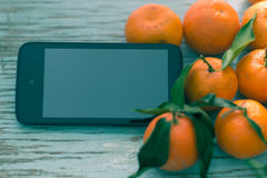 Fresh tangerines in a blue wooden board Royalty Free Stock Photo