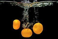 Fresh tangerines dropped into water Royalty Free Stock Image