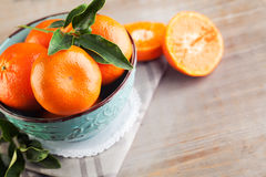 Fresh Tangerines with Green Leaves Royalty Free Stock Images