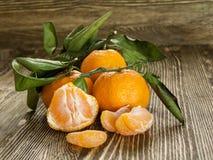 Fresh tangerine on wooden background royalty free stock photos
