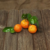Fresh tangerines with leaves on a wooden table. Stock Images