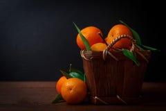 Fresh tangerines in old box Stock Photo