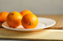 The fresh tangerines on plate Royalty Free Stock Image