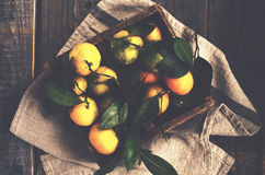 Fresh tangerines in rustic wooden box, top view Stock Photography