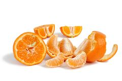 Fresh tangerines slices and wedges on a white background Stock Images