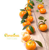 Fresh tangerines on the table isolated on white Royalty Free Stock Images