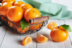 Fresh tangerines. And vintage metal basket on white wooden background Stock Photography