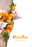 Fresh tangerines on wood isolated on white, space for text Royalty Free Stock Photo