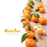 Fresh tangerines on wood isolated on white Royalty Free Stock Images
