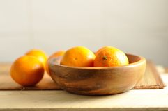The fresh tangerines on wood plate Royalty Free Stock Images
