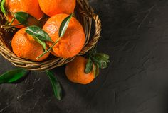 Fresh tangerines on a wooden tray. On a rustic background stock photography