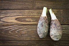 Fresh taro on wooden background. Stock Images