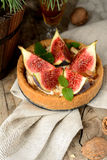 Fresh tart or pie with figs, cream and mint Royalty Free Stock Photos