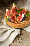 Fresh tart or pie with figs, cream and mint Royalty Free Stock Image