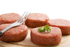 Fresh tartaar. Fresh raw meat with a fork isolated over white Stock Photos