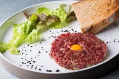 Tartar dish on a white plate Royalty Free Stock Photo