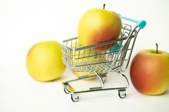 Fresh tasty apples in store carts. Concept for purchasing in the grocery shop stock photography