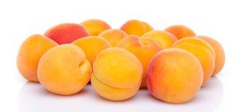 Fresh tasty apricots. Isolated on white Stock Photos