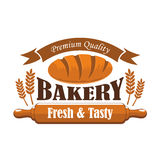 Fresh tasty bakery products premium quality label. Vector icon of brown rye bread bun bagel, wheat ears, wooden rolling pin, ribbon with text. Bakery shop Stock Image