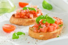Fresh and tasty bruschetta with basil and tomato Royalty Free Stock Image