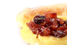 Fresh and tasty buns with raisins. Over white background Royalty Free Stock Image