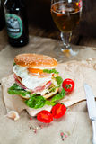 Fresh tasty burger. With vegetables and meat Royalty Free Stock Photography