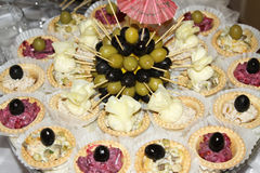 Fresh tasty canapes with olives Stock Images
