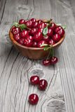 Fresh and tasty cherries on woden table Royalty Free Stock Photo