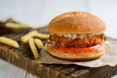 Fresh tasty chicken burger. On wooden table stock images