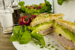 Fresh tasty club sandwich with cheese and ham on table Stock Photos