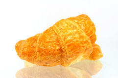 Croissant over white background. Fresh and tasty croissant over white background Stock Photography