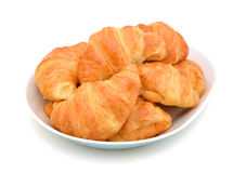 Fresh and tasty croissant in plate Royalty Free Stock Images