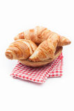 Fresh and tasty croissant on red checkered napkin Stock Images