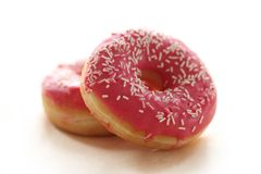 Fresh tasty donuts with pink glaze Royalty Free Stock Images