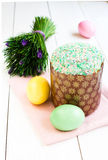 Fresh and tasty Easter cake and eggs with flowers Stock Images