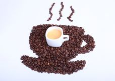 Fresh tasty espresso cup of hot coffee with coffee beans on white background. Royalty Free Stock Photo