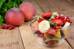Fresh tasty fruit salad Stock Photos
