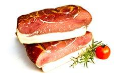 Fresh tasty ham with tomato. Fresh tasty ham in detail Royalty Free Stock Images