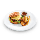 Fresh tasty hamburger with fried potatoes and salsa. Dip on a round plate isolated on white royalty free stock photo