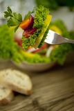 Fresh tasty healthy mixed salad and bread on table Stock Photos