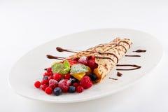 Fresh tasty homemade crepe pancake and fruits Stock Photos