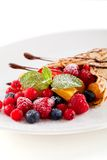 Fresh tasty homemade crepe pancake and fruits Stock Photos