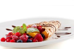 Fresh tasty homemade crepe pancake and fruits Royalty Free Stock Photography